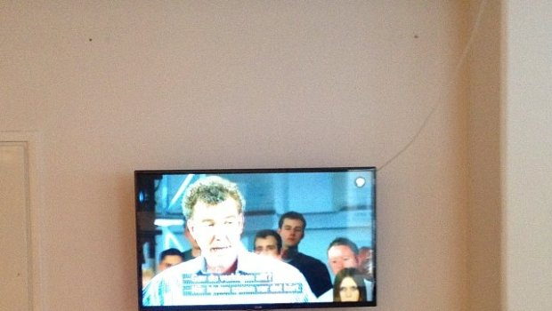 Lunch break @ #norkayagency with Top Gear on the tv.. Could be worse, they slaughter a Mercedes!
